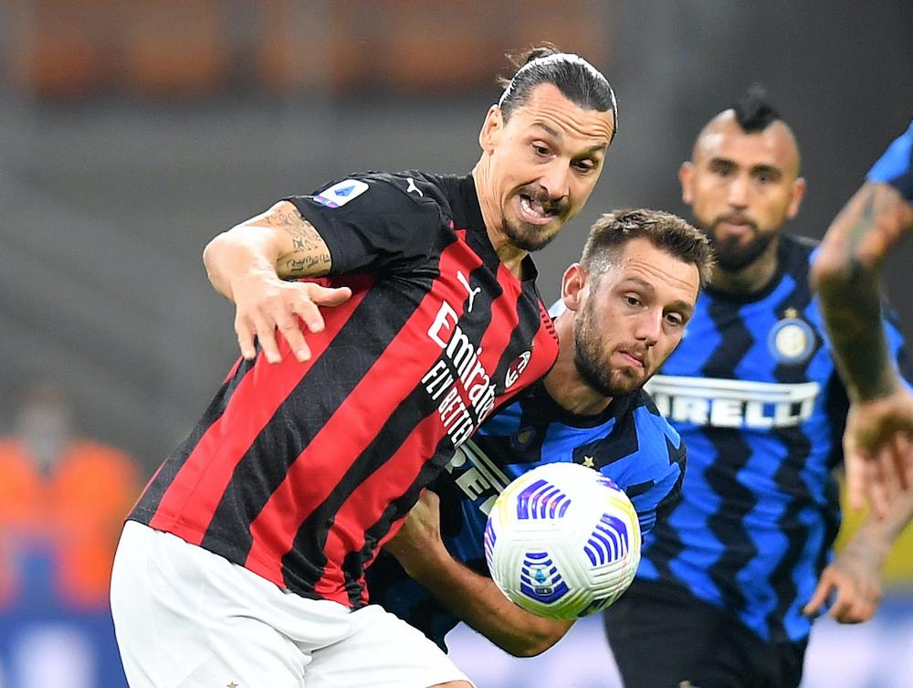 AC Milan's Zlatan Ibrahimovic in action with Inter Milan's Stefan de Vrij, October 18, 2020. — Reuters pic