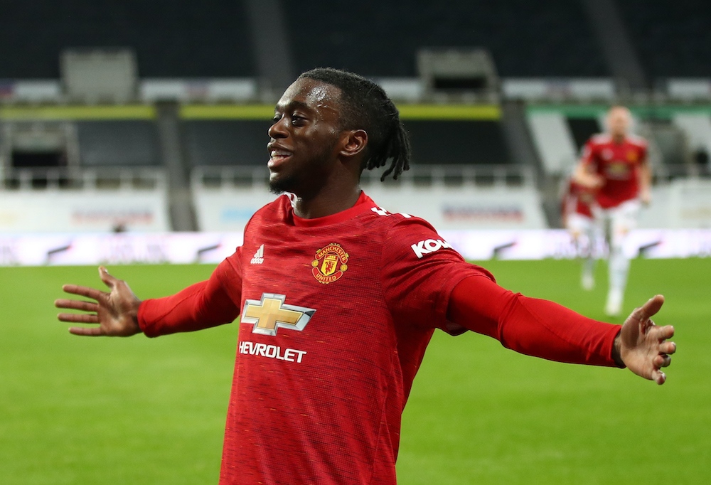 Manchester United's Aaron Wan-Bissaka celebrates scoring their third goal against Newcastle, October 18, 2020. — Pool via Reuters/Alex Pantling