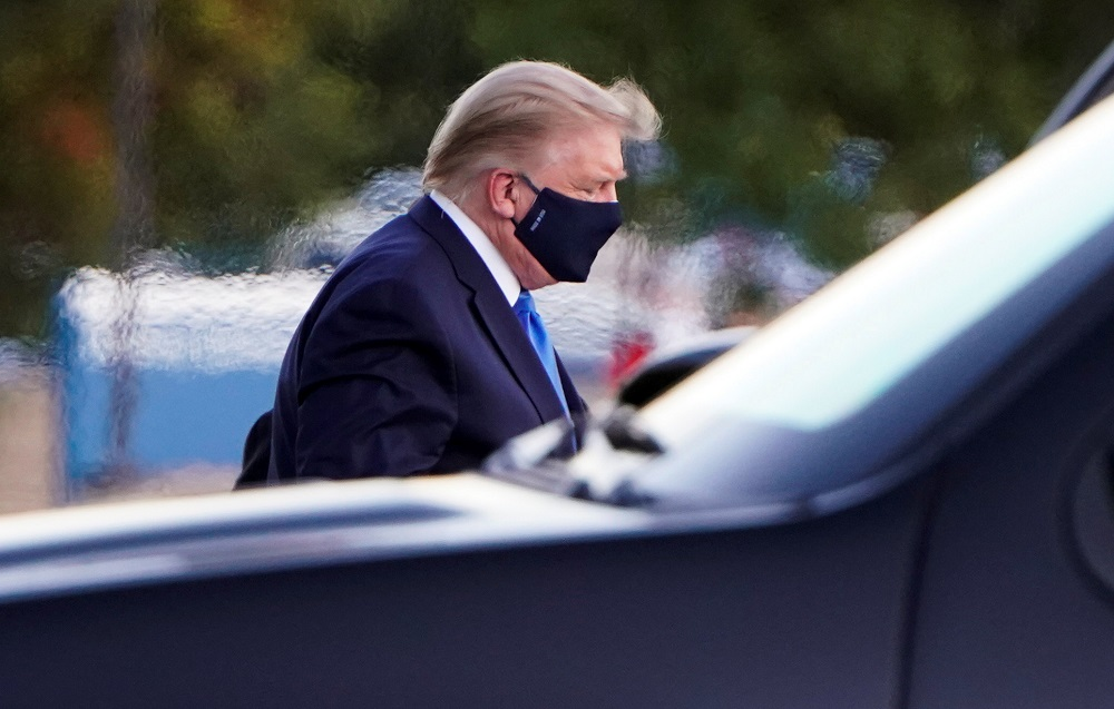 US President Donald Trump arrives at Walter Reed National Military Medical Centre by helicopter in Bethesda, Maryland October 2, 2020. — Reuters pic