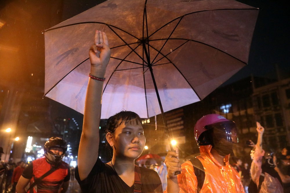 A protestor shows the three-finger salute during anti-government protests, in Bangkok October 16, 2020. — Reuters pic