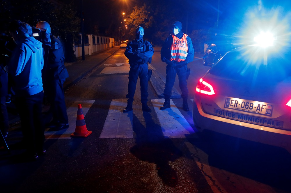 Police officers secure the area near the scene of a stabbing attack in the Paris suburb of Conflans St Honourine, France October 16, 2020. — Reuters pic