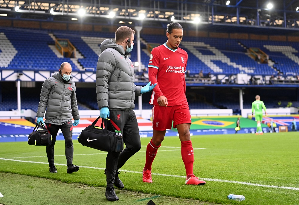 Liverpool's Virgil van Dijk receives medical attention after sustaining an injury during their match at Goodison Park in Liverpool October 17, 2020. — Pool pic via Reuters