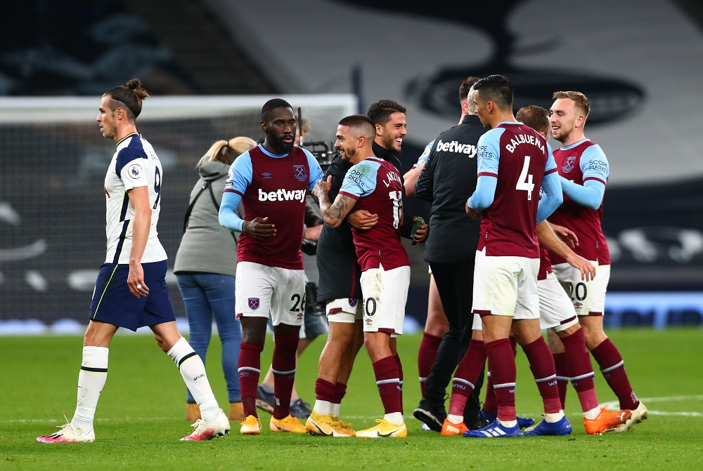 Tottenham Hotspur's Gareth Bale looks dejected after the match as West Ham United's Manuel Lanzini celebrates with teammates during their match at Tottenham Hotspur Stadium in London October 18, 2020. — Pool pic via Reuters