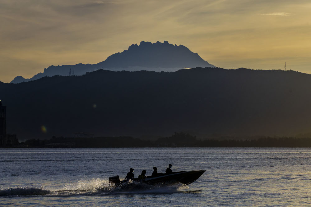 A speedboat passes the Mount Kinabalu September 30, 2020. — Picture by Firdaus Latif