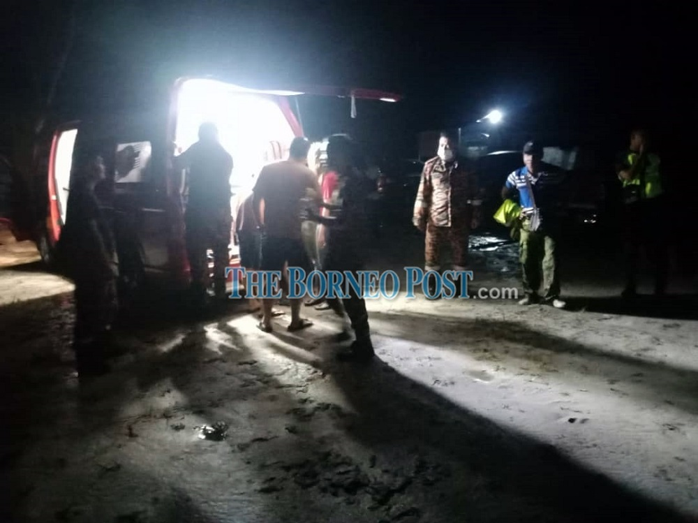 The victims were attended by the Bomba personnel after being rescued last night. — Borneo Post Online pic