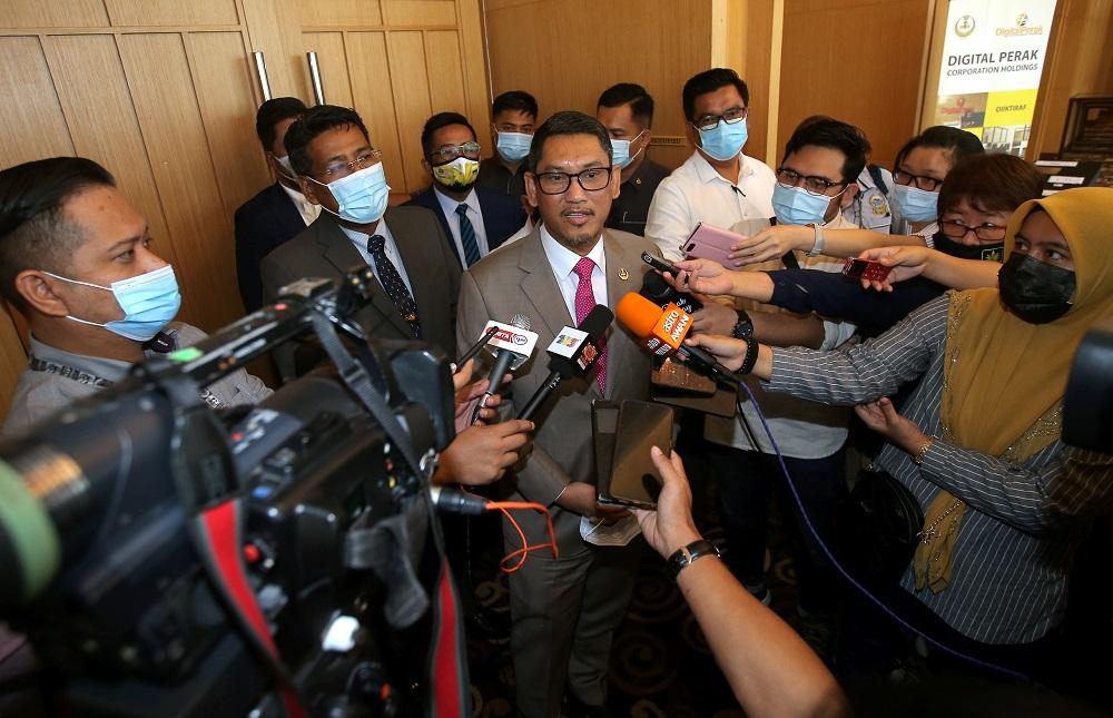 Datuk Seri Ahmad Faizal Azumu speaking to press at the Weil Hotel in Ipoh October 9, 2020. — Picture by Farhan Najib