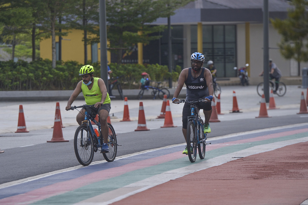 Cyclists are seen at Bukit Jalil Stadium during the conditional movement control order on October 14, 2020. — Picture by Miera Zulyana