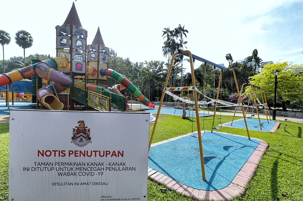 A closure notice is seen at the playground area of Taman Botani Perdana in Kuala Lumpur October 19, 2020.