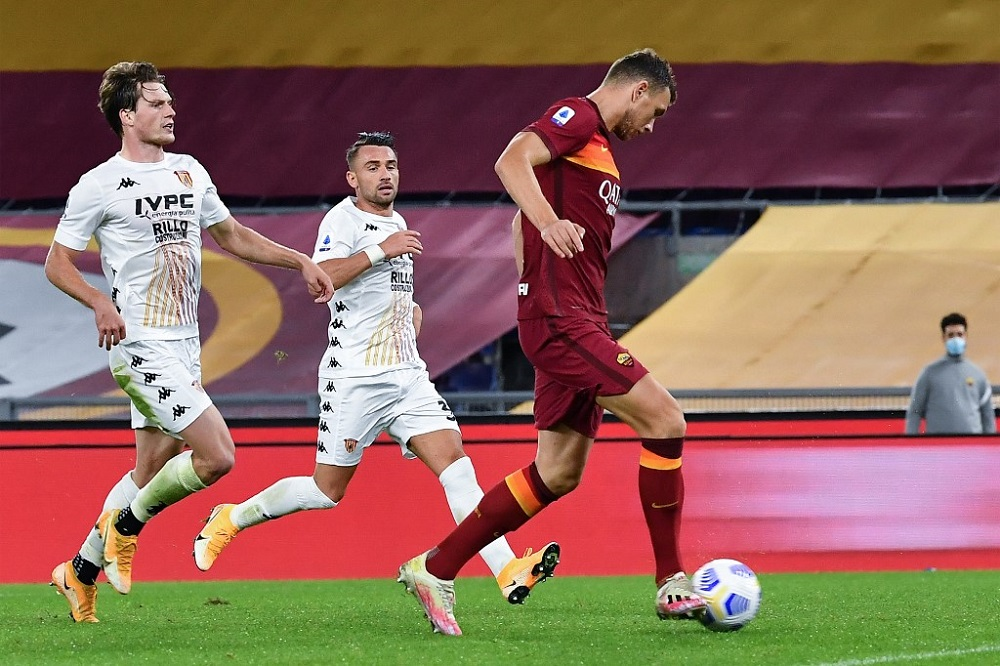 AS Roma's Bosnian forward Edin Dzeko (right) scores during the Italian Serie A football match Roma vs Benevento at Olympic stadium in Rome October 18, 2020. — AFP pic