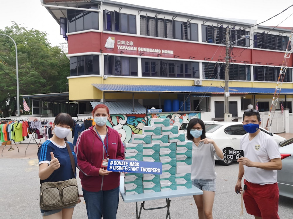 Yum and the MBSKL Class of '87 have been donating masks and necessities to underprivileged communities since March this year. — Picture courtesy of KC Yum.