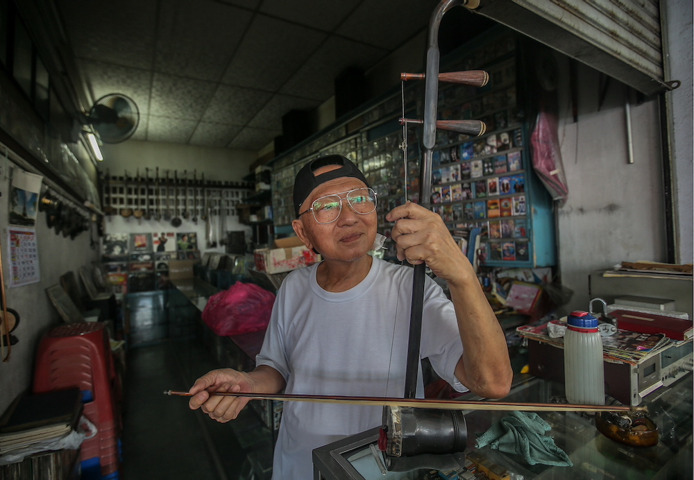 Cheng often finds himself wiling the time away at his store playing the erhu. — Picture by Farhan Najib