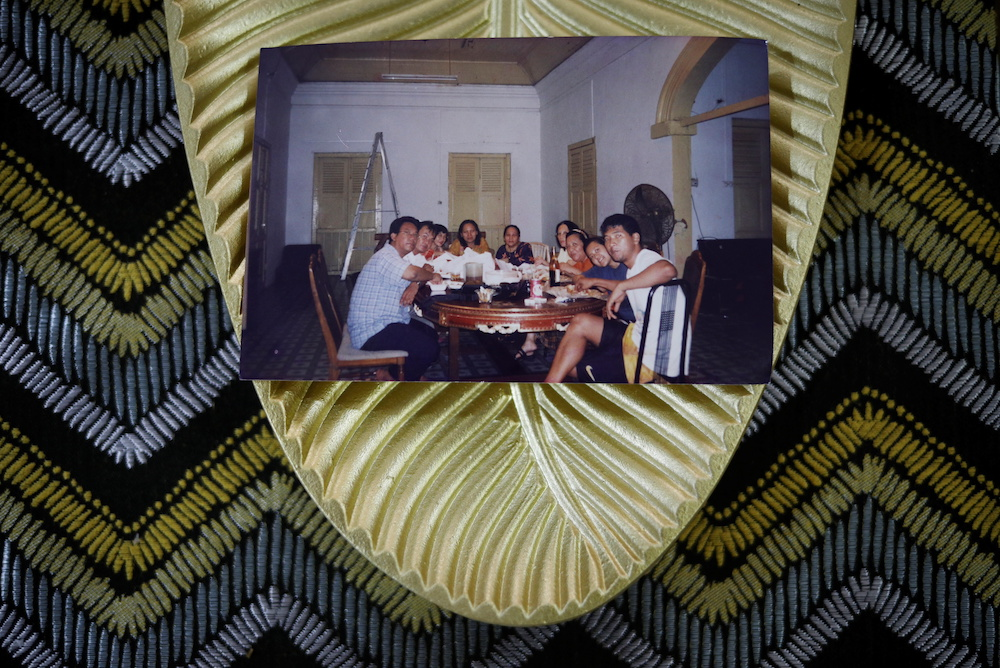 An old 1999 family photo shows royal descendant Tengku Shawal (left) having a meal together with relatives in their last days at their home, Istana Kampong Glam, in Singapore August 21, 2020. — Reuters pic