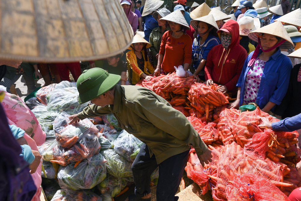 Flood-affected residents receive food relief at My Thuong Loc village in Quang Binh province, Vietnam October 26, 2020. — Reuters pic