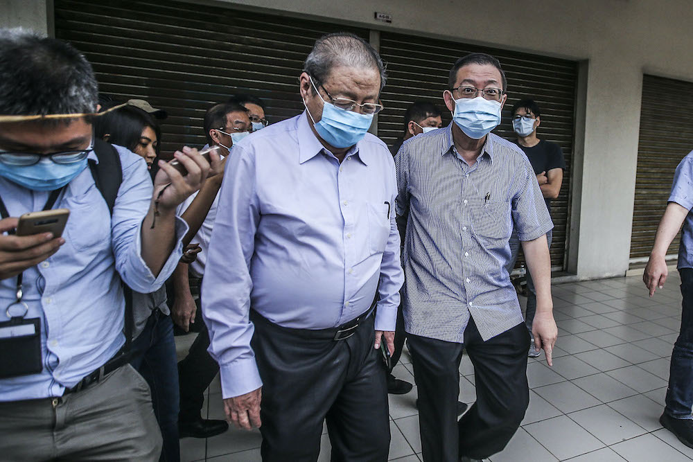 DAP veteran Lim Kit Siang and DAP secretary-general Lim Guan Eng leave PKR's headquarters after meeting with Pakatan Harapan presidential council in Petaling Jaya October 29, 2020. — Picture by Hari Anggara