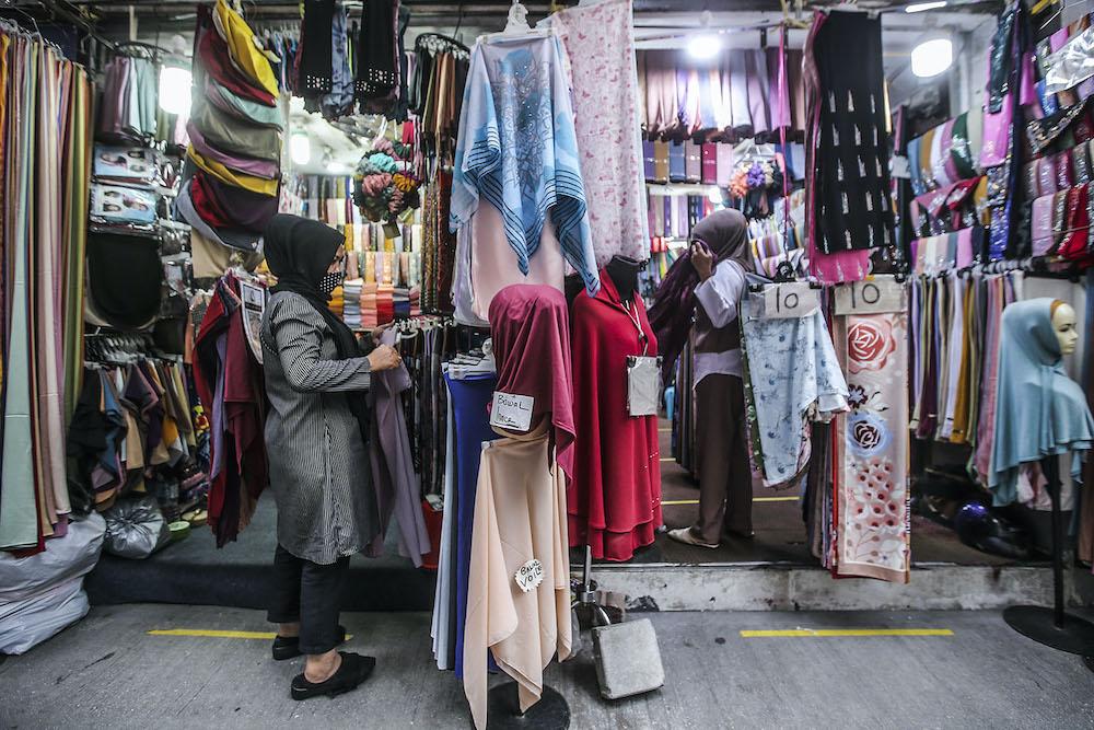 Traders along Jalan Tuanku Abdul Rahman in Kuala Lumpur struggle to survive as customers stay away amid the Covid-19 pandemic, October 29, 2020. — Picture by Hari Anggara