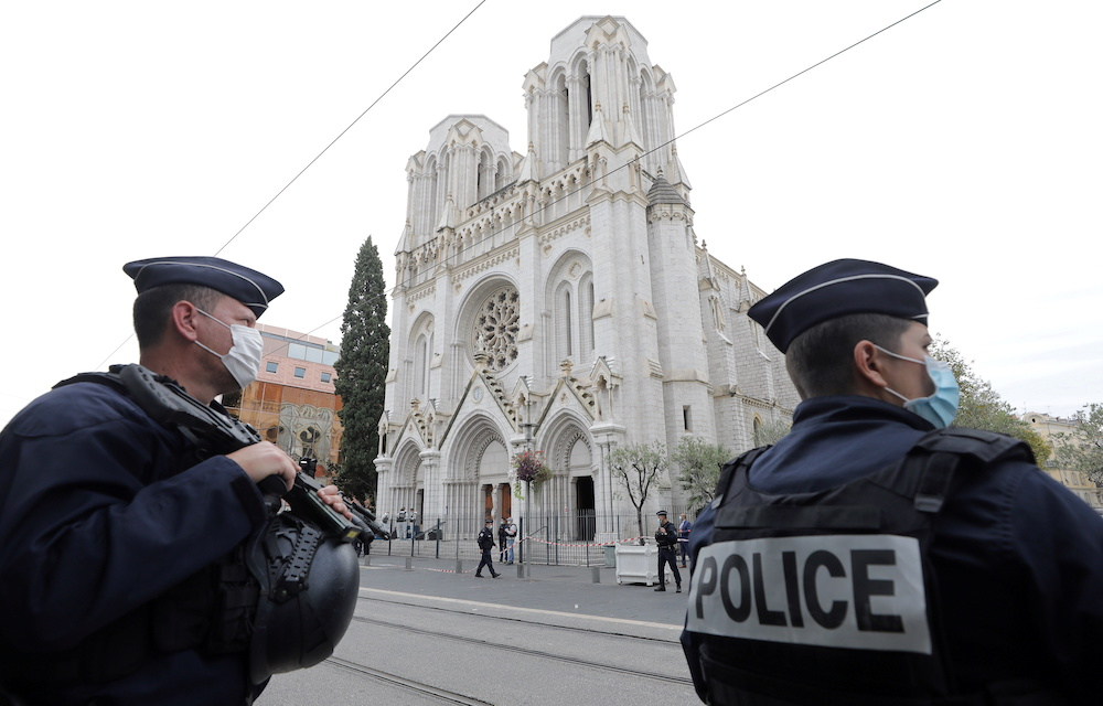 Police officers stand guard at the scene of a reported knife attack at Notre Dame church in Nice, France, October 29, 2020. — Reuters pic