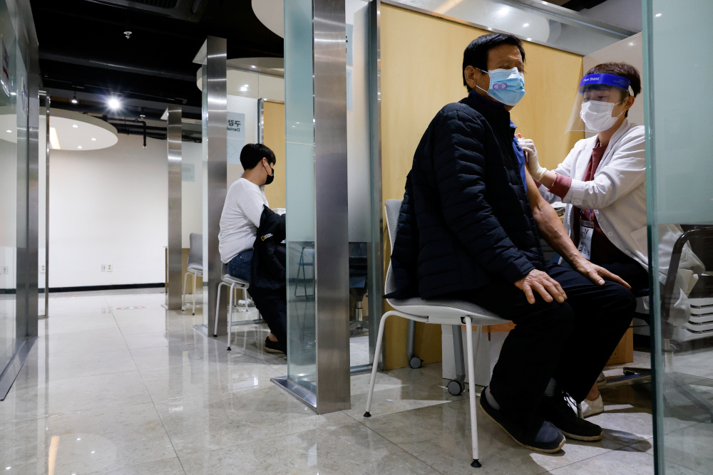 A man gets an influenza vaccine at a branch of the Korea Association of Health Promotion in Seoul, South Korea, October 23, 2020. — Reuters pic