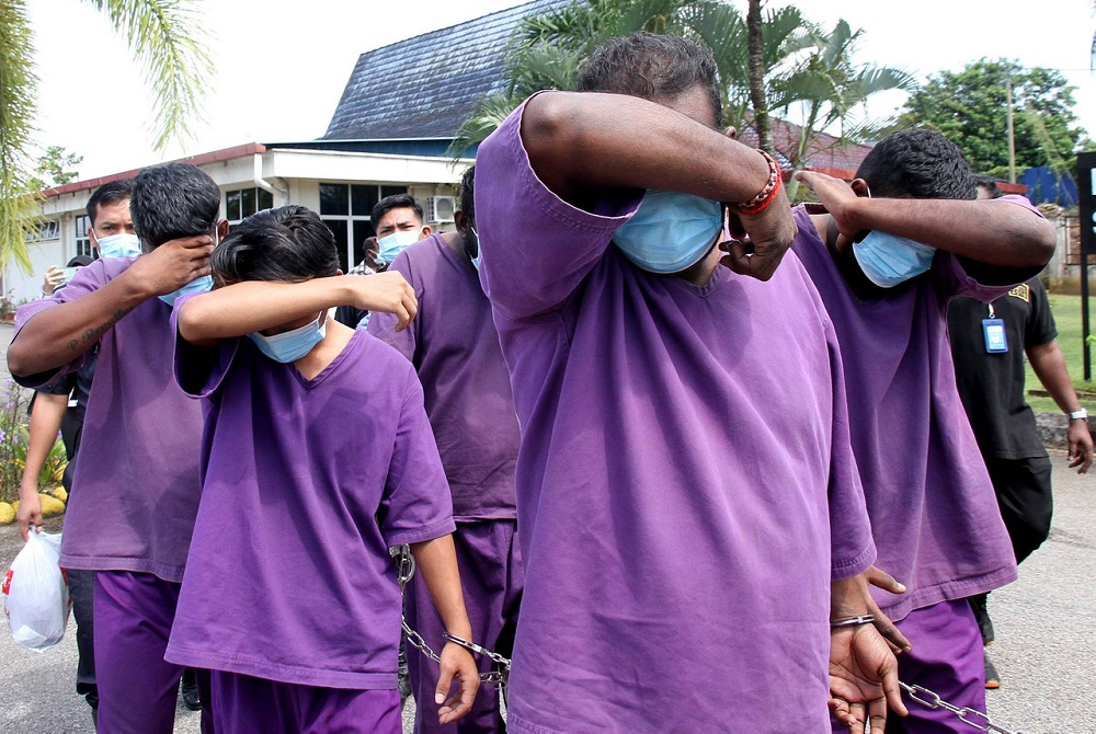 The four accused are led to the Magistrate's Court in Tanjung Malim October 20, 2020. — Bernama pic