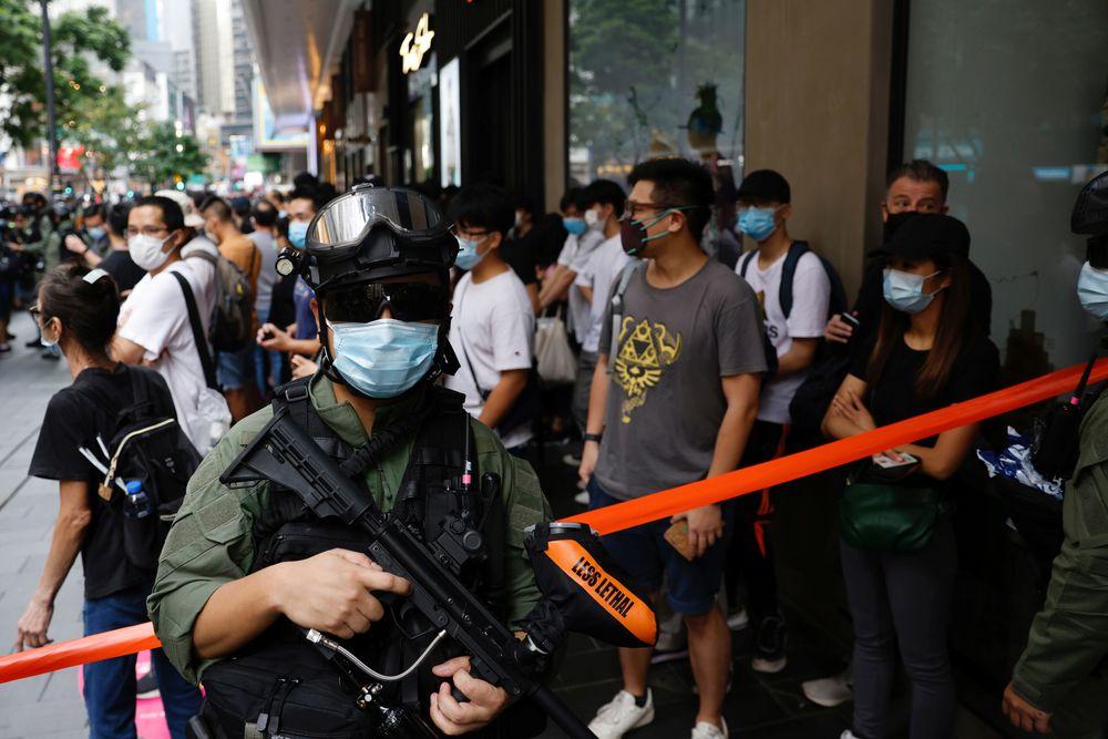 China anniversary arrests as Hong Kong leader hails 'return to peace'