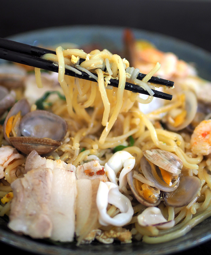 The yellow noodles and beehoon are fried with garlic and egg
