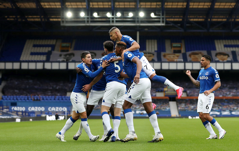 Everton's Michael Keane celebrates scoring their first goal with teammates during their match against Liverpool at Goodison Park in Liverpool, October 17, 2020. — Reuters pic