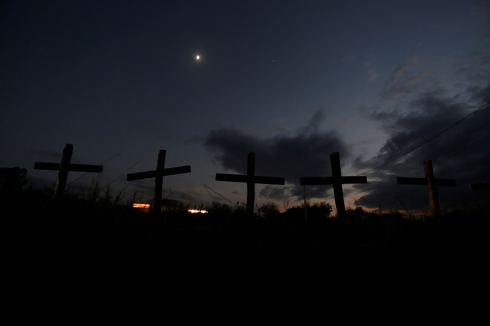 Crosses that represent 65 miners who died during an explosion in 2006 in Pasta de Conchos coal mine, are seen along a highway in San Juan de Sabinas, Mexico October 23, 2020. ― Reuters pic