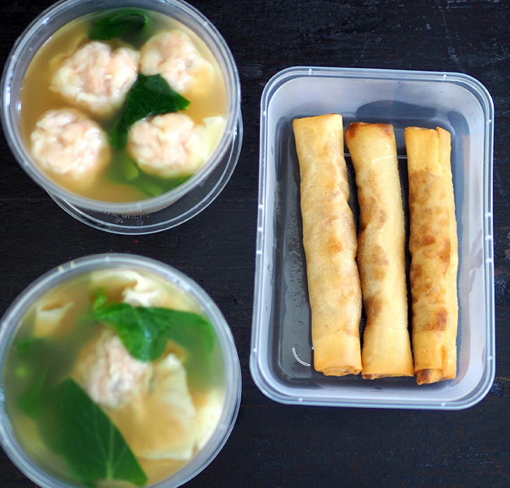 The 'wantons' and pork dumplings are served with the clear pork bone soup while the spring rolls are kept whole.
