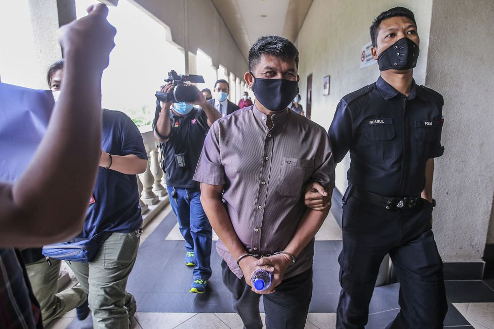 Mohd Azhar Che Mat Dali (left) pleaded not guilty after both charges were read out to him before Judge Rofiah Mohamad. — Picture by Hari Anggara