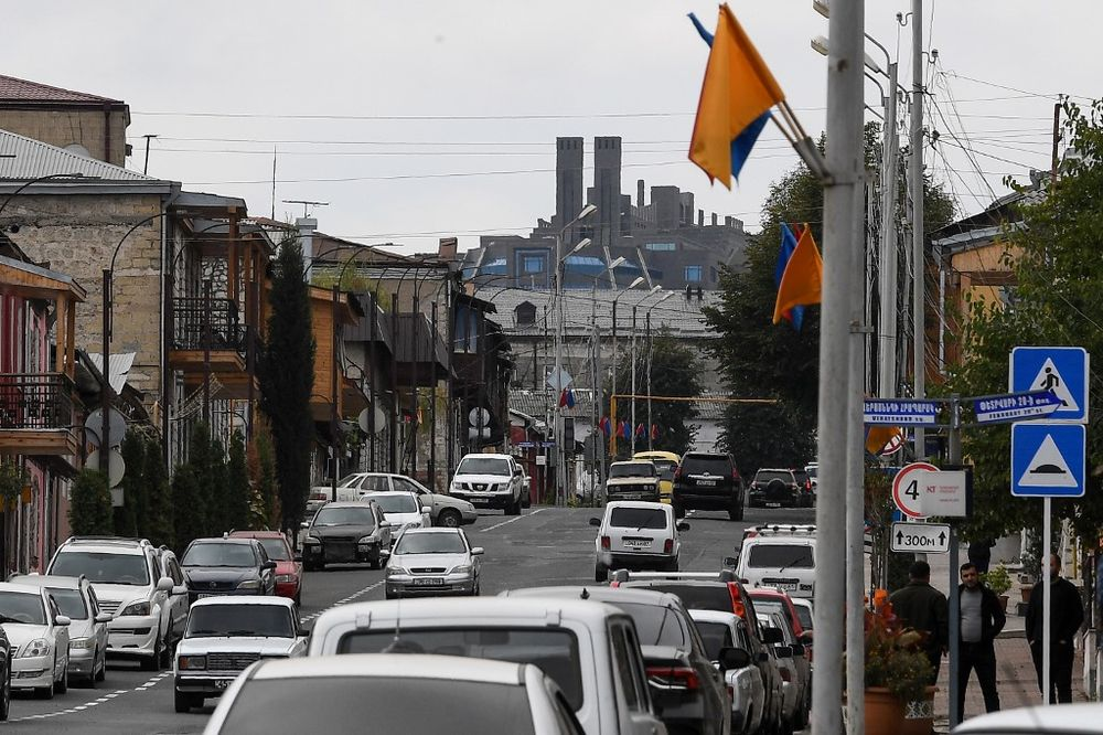 Cars drive on a street in the breakaway Nagorny Karabakh's main city of Stepanakert on October 2, 2020, during the ongoing fighting between Armenia and Azerbaijan over the disputed region. — AFP pic