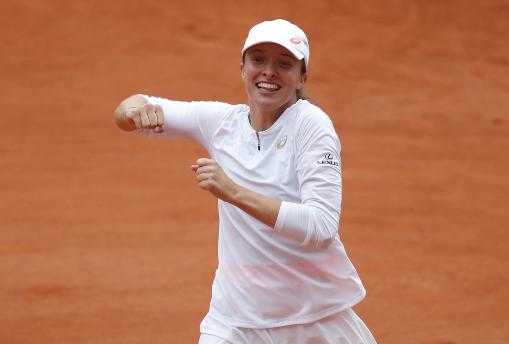 Poland's Iga Swiatek celebrates after winning the French Open final against Sofia Kenin of the US at the Roland Garros in Paris, October 10, 2020. ― Reuters pic