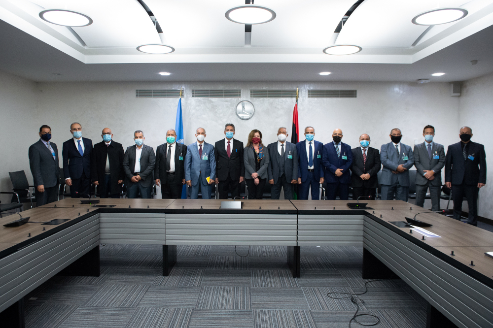 This handout picture released October 19, 2020 shows deputy special representative of the UN Secretary-General for Political Affairs in Libya Stephanie Williams and representatives of the rival factions in the Libya conflict at the beginning of talks in Geneva. — United Nations handout pic via AFP