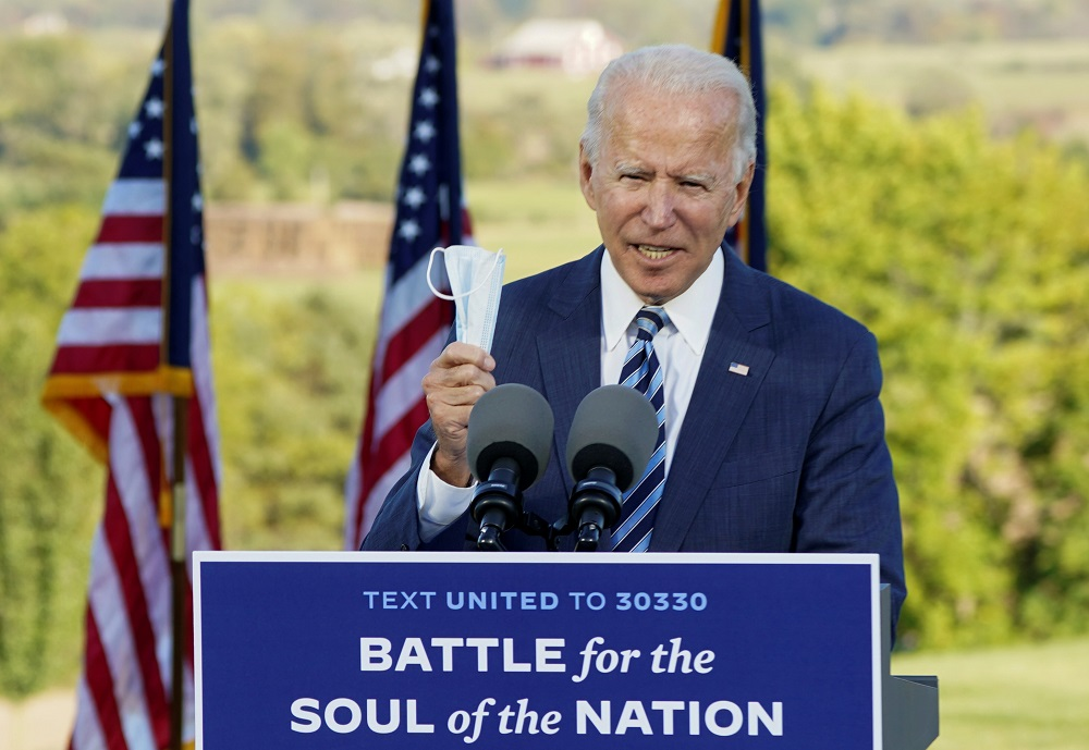 Biden said that if he is elected he would be focused on bringing the pandemic to heel, and to help struggling Americans with the costs. ― Reuters pic