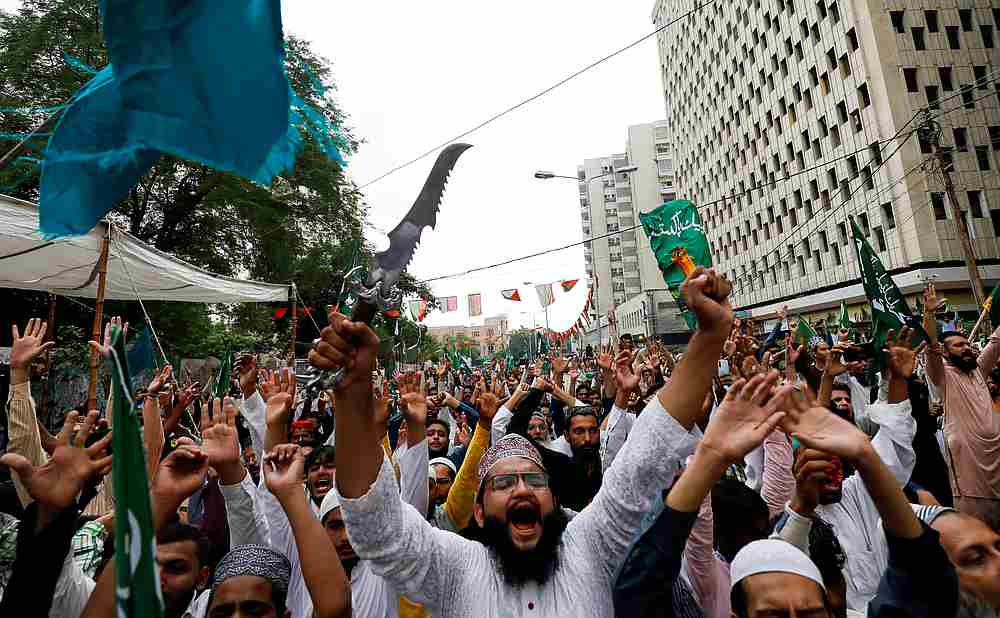 A supporter of Tehreek-e-Labaik Pakistan (TLP) waves a dagger, as he chants slogans with others against the satirical French weekly newspaper 'Charlie Hebdo,' during a protest in Karachi, Pakistan September 4, 2020. — Reuters pic