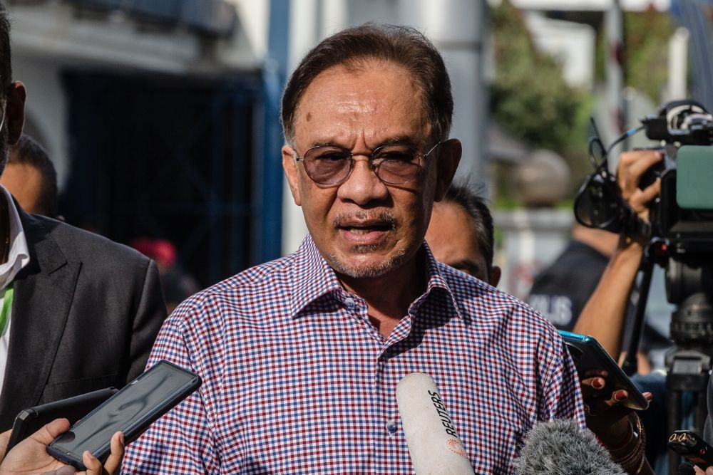 Datuk Seri Anwar Ibrahim speaks to reporters after giving his statement to the police at Bukit Aman in Kuala Lumpur October 16, 2020. — Picture by Firdaus Latif