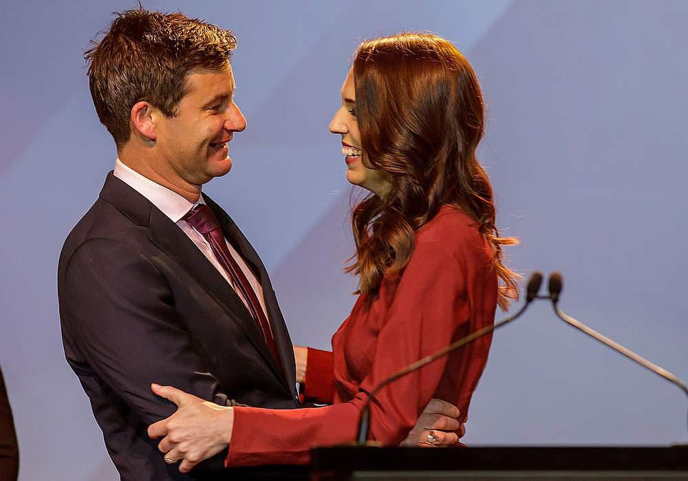 New Zealand Prime Minister Jacinda Ardern greets Clarke Gayford at the Labour Party election night event as she claims victory in the general election in Auckland