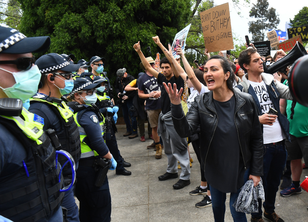 Protesters confront police during an anti-lockdown rally in Melbourne October 23, 2020, amid the Covid-19 coronavirus pandemic. — AFP pic