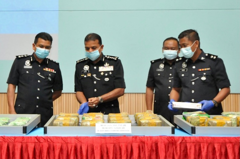 Johor police chief Datuk Ayob Khan Mydin Pitchay (second from left) inspecting the seized narcotics at the Johor police contingent headquarters in Johor Baru October 19, 2020. — Picture by Ben Tan