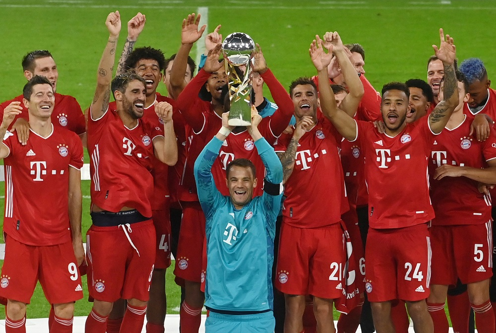 Bayern Munich's Manuel Neuer and teammates celebrate with the trophy after winning the Supercup, October 1, 2020. ― Reuters pic