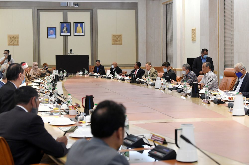Prime Minister Tan Sri Muhyiddin Yassin chairing a special National Security Council meeting on Covid-19 at Perdana Putra building October 3, 2020. — Bernama pic