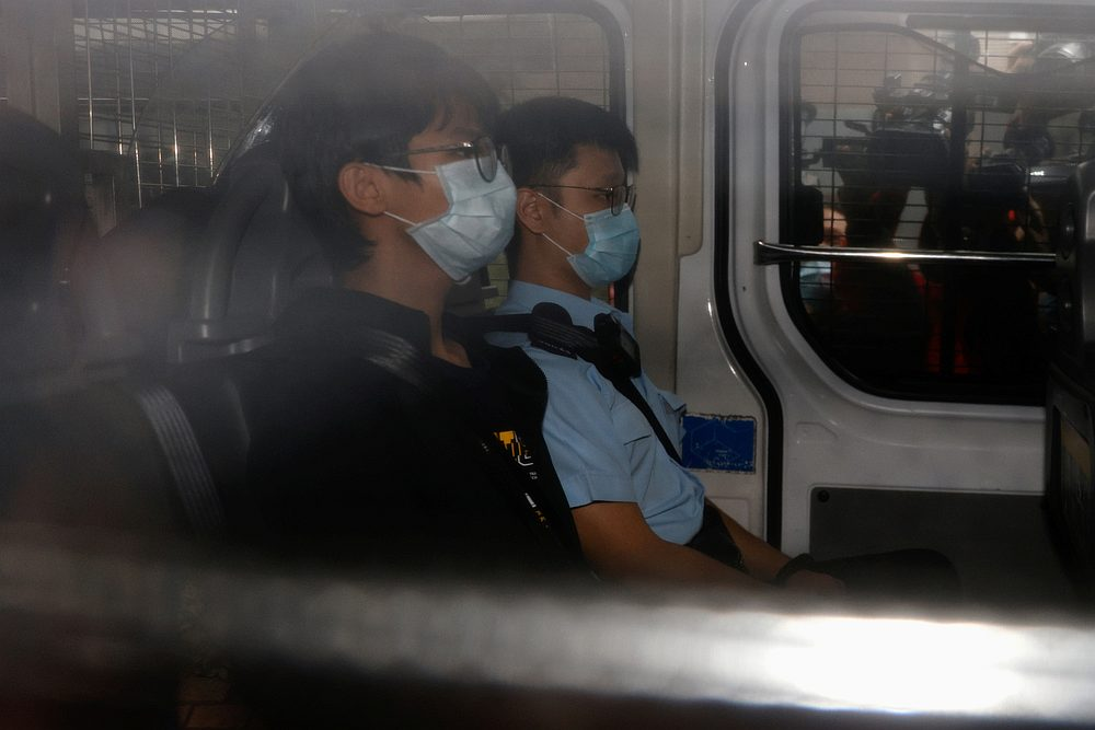 Former convenor of pro-independence group Studentlocalism, Tony Chung Hon-lam, arrives at West Kowloon Magistrates' Courts in a police van in Hong Kong October 29, 2020. — Reuters pic