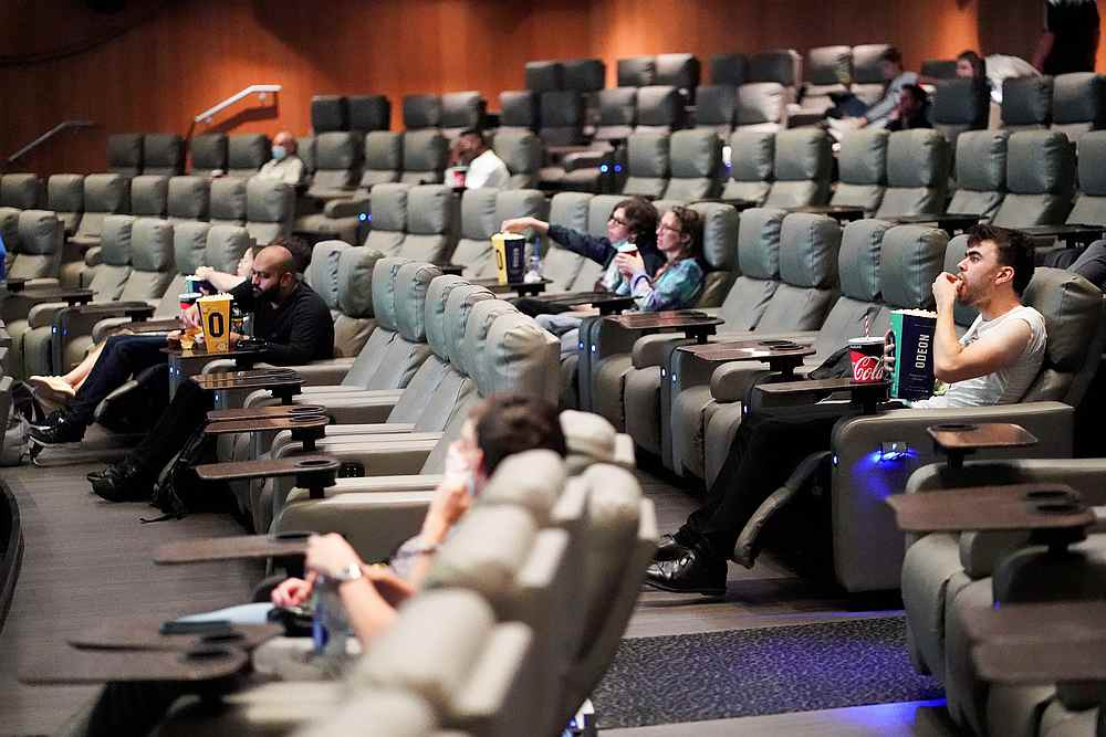 People take their seats inside the Odeon Luxe Leicester Square cinema, on the opening day of the film 'Tenet,' amid the Covid-19 outbreak, in London, Britain August 26, 2020. — Reuters pic