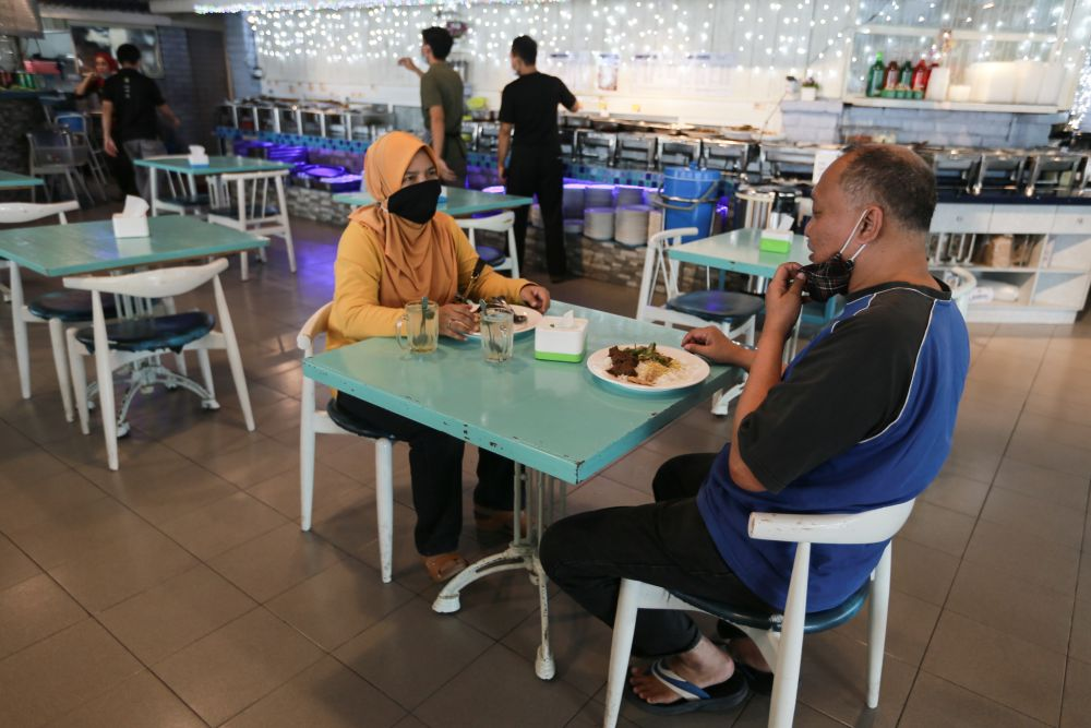 People dining at a restaurant in Selangor as the conditional movement control order kicks in October 14, 2020. — Picture by Ahmad Zamzahuri