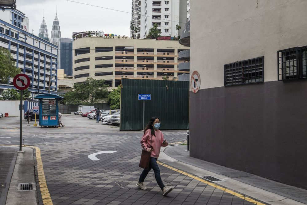 A woman is seen walking along Jalan Tuanku Abdul Rahman amid the conditional movement control order in Kuala Lumpur October 23, 2020. — Picture by Firdaus Latif