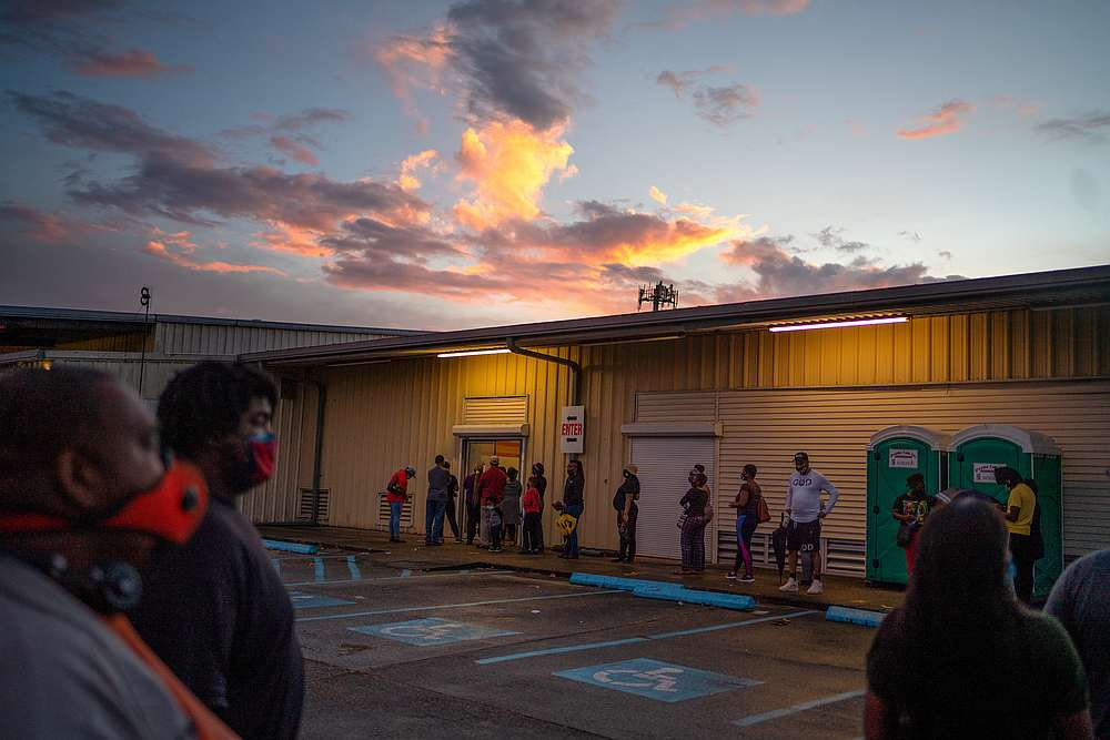 People line up to cast their ballot for the upcoming presidential election as early voting ends as tropical storm Zeta approaches the Gulf Coast in New Orleans, Louisiana October 27, 2020. — Reuters pic