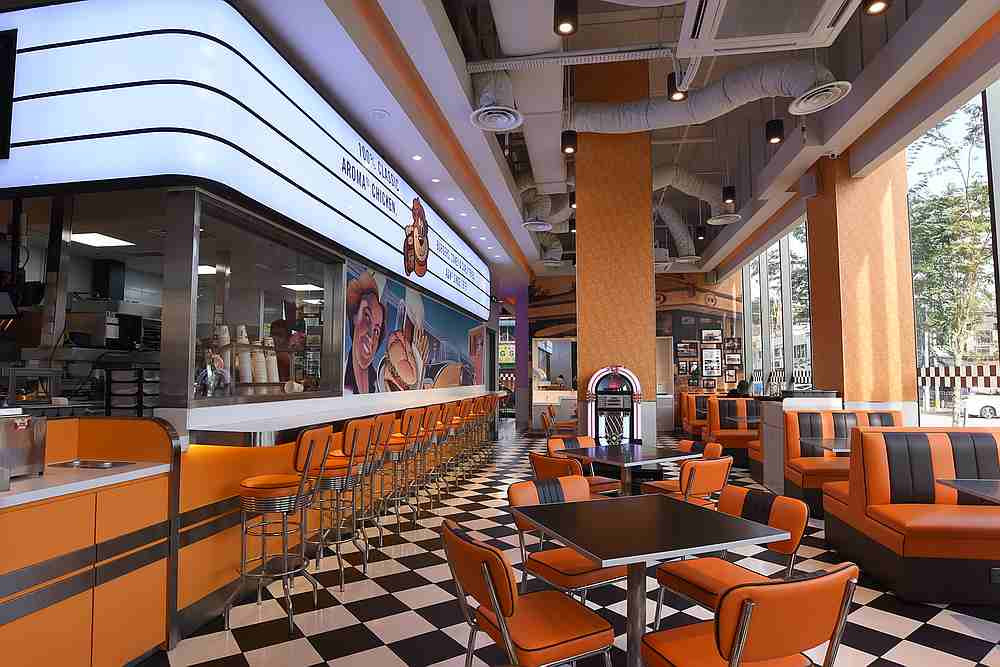 The A&W in Seventeen Mall has a vibrant retro outlook and even a working Jukebox for guests to tune in while enjoying their meals. — Picture by Arif Zikri