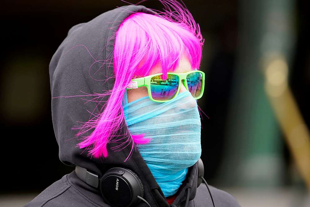 A person wears a scarf as a protective face mask in Melbourne after it became the first city in Australia to enforce mask-wearing in public, July 23, 2020. — Reuters pic