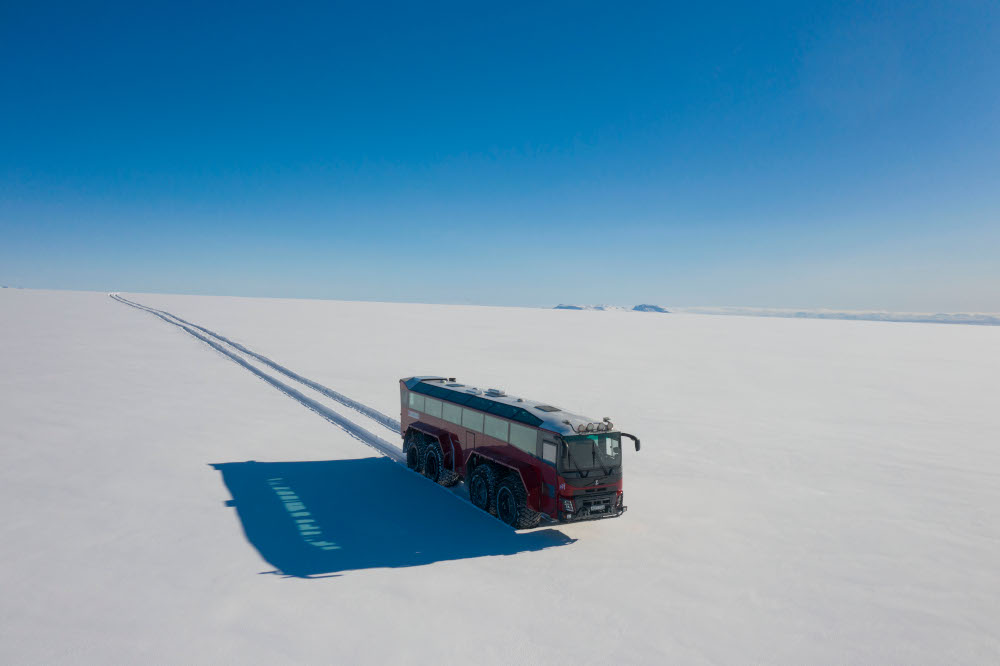 This aerial picture shows the red painted 'glacier bus', a 15 metre-long bus fitted with massive tires, driving at Langjokull ice cap in Iceland, October 1, 2020. — AFP pic