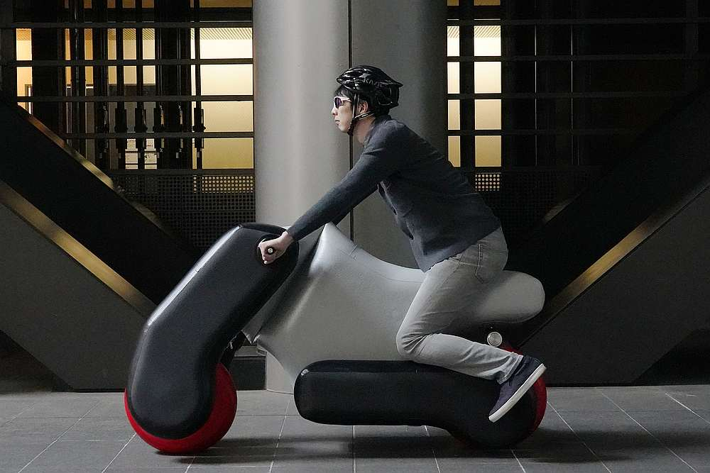 Researchers in Japan have developed a prototype electric scooter with inflatable components that can be custom fit to your riding position. — Picture courtesy of University of Tokyo via AFP