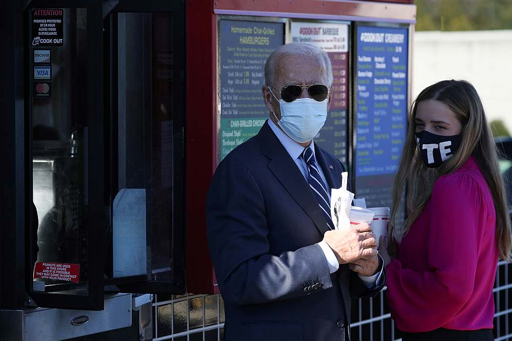 US Democratic presidential candidate Joe Biden with his granddaughter Finnegan Biden hold milkshakes outside a Cook Out restaurant in Durham, North Carolina October 18, 2020. — Reuters pic