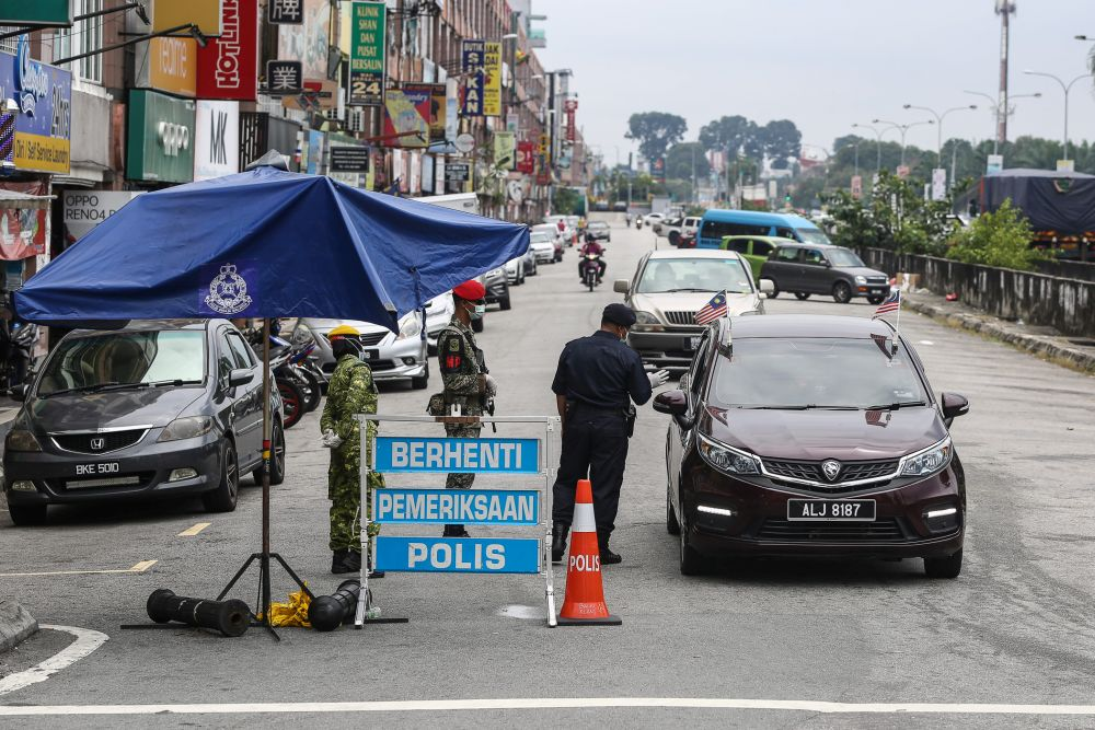 Police and Armed Forces personnel conduct checks during a roadblock on Jalan Batu Unjur  in Klang October 11, 2020. — Picture by Yusof Mat Isa